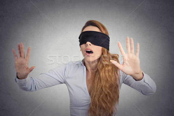 Young businesswoman walking blindfolded with hands forward Stock photo © ichiosea