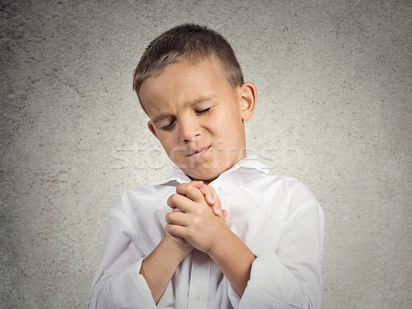 Praying child, boy hopeful for best Stock photo © ichiosea