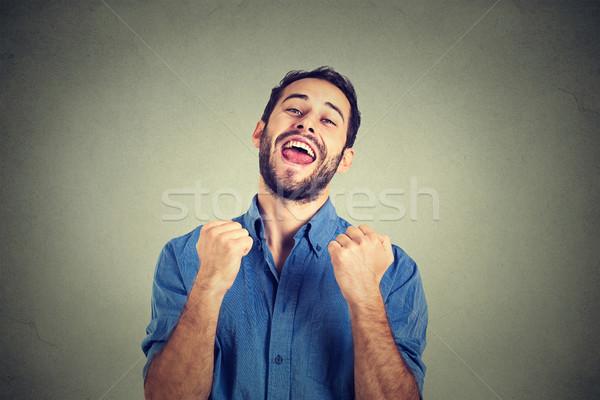 happy successful student, business man winning, fists pumped celebrating success Stock photo © ichiosea