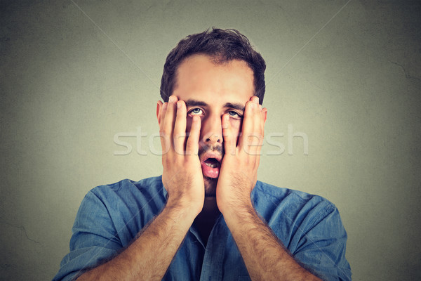 portrait of desperate unhappy man isolated on gray wall background  Stock photo © ichiosea