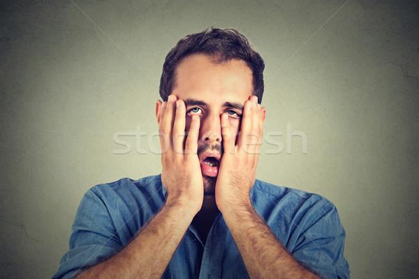 Retrato desesperado infeliz homem isolado cinza Foto stock © ichiosea