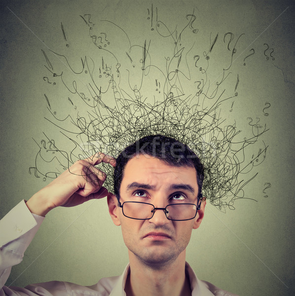 man scratching head, thinking with brain melting into many lines question marks Stock photo © ichiosea