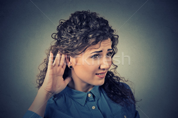 nosy woman hand to ear gesture carefully secretly listen in on juicy gossip  Stock photo © ichiosea