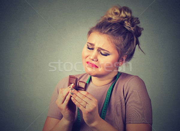 woman with measuring tape tired of diet restrictions craving sweets chocolate Stock photo © ichiosea