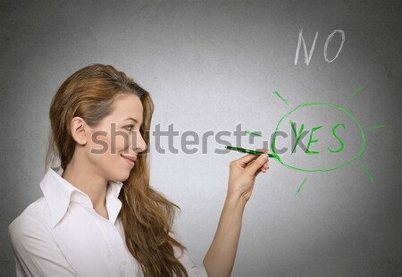 Angry woman screaming with fist up in air  Stock photo © ichiosea
