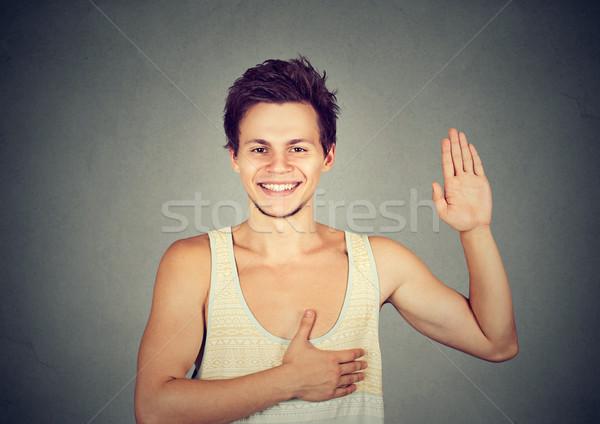 Fiatal boldog mosolyog férfi készít ígéret Stock fotó © ichiosea