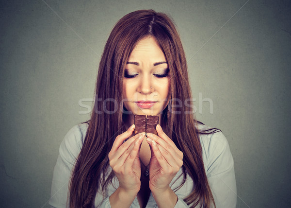 sad woman tired of diet restrictions craving chocolate Stock photo © ichiosea