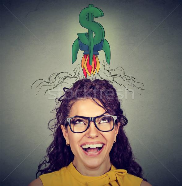 Woman looking up at dollar sign   Stock photo © ichiosea