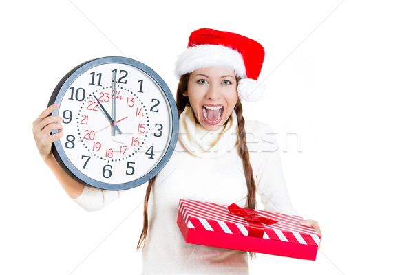 Excited christmas girl holding clock and gift  Stock photo © ichiosea