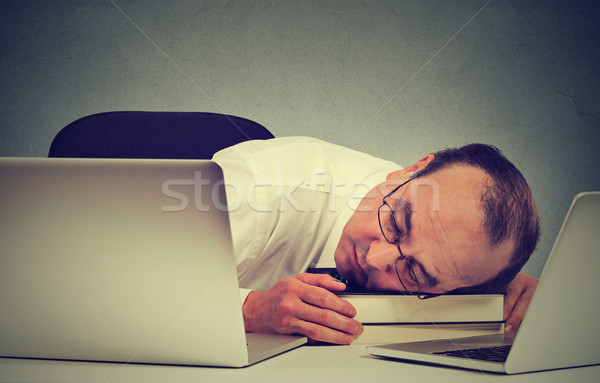 Businessman sleeping at his desk with laptop, tired middle aged guy employee Stock photo © ichiosea