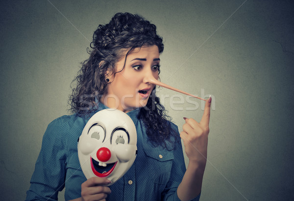 Woman with long nose and clown mask. Liar concept Stock photo © ichiosea