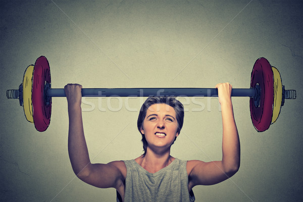 Strong woman lifting heavy barbell. Determination task completion hard work concept Stock photo © ichiosea