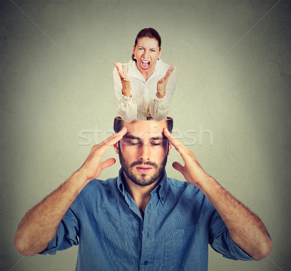 Stressed man with open head and screaming woman inside his brain Stock photo © ichiosea