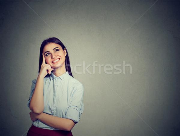 портрет счастливым женщину мышления улыбаясь Сток-фото © ichiosea