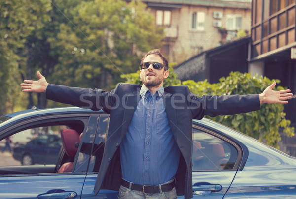 Successful man standing by his new car enjoying summer day  Stock photo © ichiosea