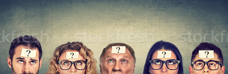 Stock photo: Multiethnic group of thinking people with question mark looking up