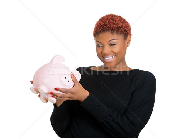 Woman holding piggy bank Stock photo © ichiosea