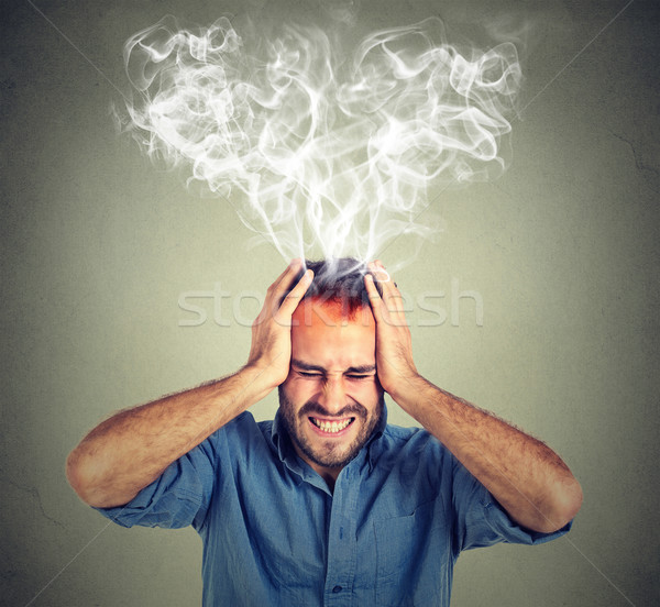 stressed man screaming thinking too hard steam coming out up of head Stock photo © ichiosea
