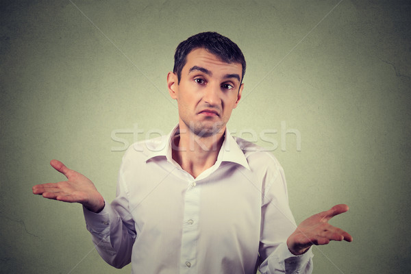 young upset man shrugging shoulders who cares so what I don't know gesture Stock photo © ichiosea