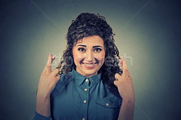 Esperanzado mujer hermosa dedos primer plano retrato Foto stock © ichiosea