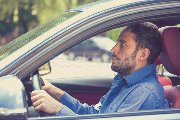 scared funny looking young man driver in the car. Inexperienced anxious motorist   Stock photo © ichiosea