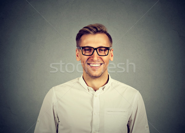 Young handsome man with great smile wearing fashion eyeglasses  Stock photo © ichiosea