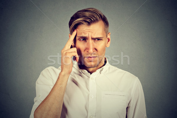 Stock photo: stressed sad young man looking down