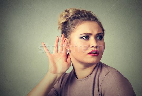 nosy woman hand to ear gesture carefully secretly listen in on gossip conversation Stock photo © ichiosea