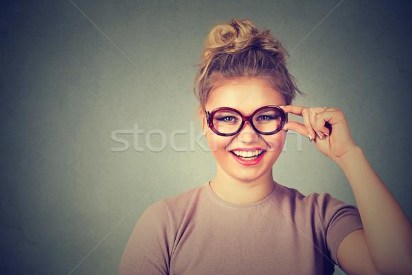 Gyönyörű boldog fiatal nő szemüveg mosolyog siker Stock fotó © ichiosea