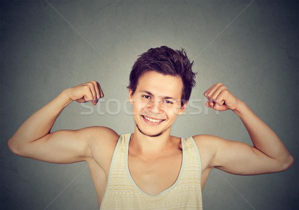Fitt izmos fiatalember bicepsz izolált szürke Stock fotó © ichiosea