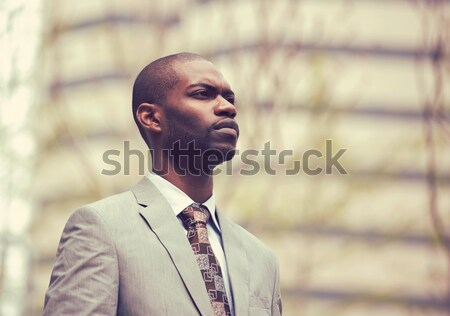 business man in a stylish suit standing outside corporate office  Stock photo © ichiosea