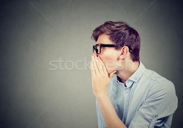 Titok férfi suttog pletyka izolált szürke Stock fotó © ichiosea