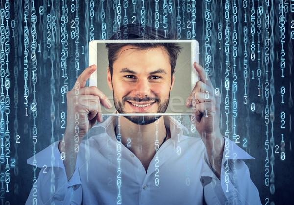 Férfi tart tabletta arc képernyő bináris kód Stock fotó © ichiosea