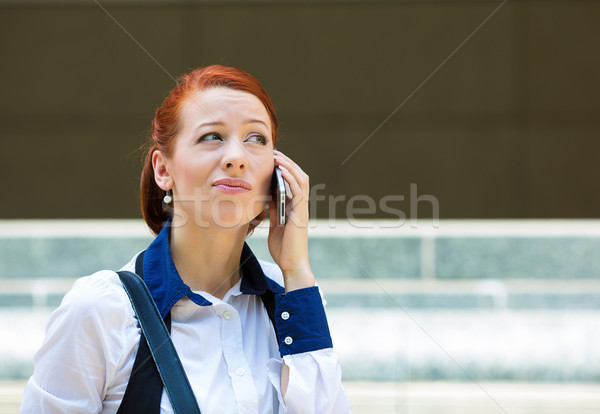 Unhappy woman receiving bad news on a phone Stock photo © ichiosea
