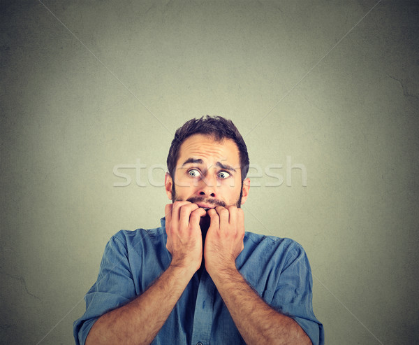 Portrait anxious young man biting his nails fingers freaking out  Stock photo © ichiosea