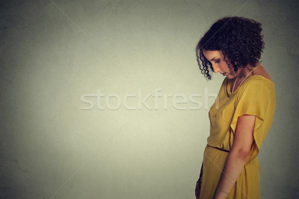 Oldal profil szomorú magányos fiatal nő lefelé néz Stock fotó © ichiosea