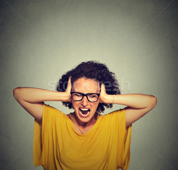 Stressed young woman screaming  Stock photo © ichiosea