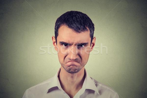 Mérges fiatalember ideges atomi közelkép portré Stock fotó © ichiosea