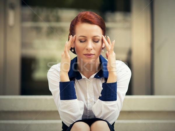 Hangsúlyos szomorú nő ül kint fejfájás Stock fotó © ichiosea