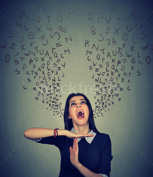 woman showing time out alphabet letters coming out of mouth Stock photo © ichiosea