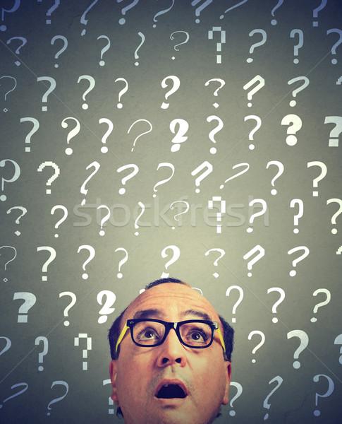 Zdjęcia stock: Zdziwiony · człowiek · wiele · pytania · działalności · twarz