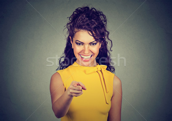ストックフォト: 笑みを浮かべて · ビジネス女性 · 黄色 · ドレス · ポインティング · 指