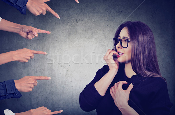 Anxious woman judged by different people Stock photo © ichiosea