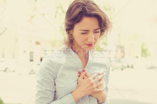 woman standing on a city street having heart pain  Stock photo © ichiosea