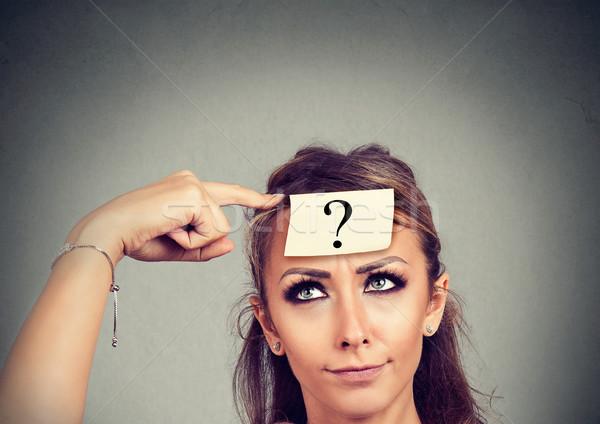 Gondolkodik tanácstalan nő kérdőjel izolált szürke Stock fotó © ichiosea