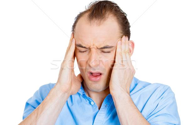 Stressed man with headache Stock photo © ichiosea