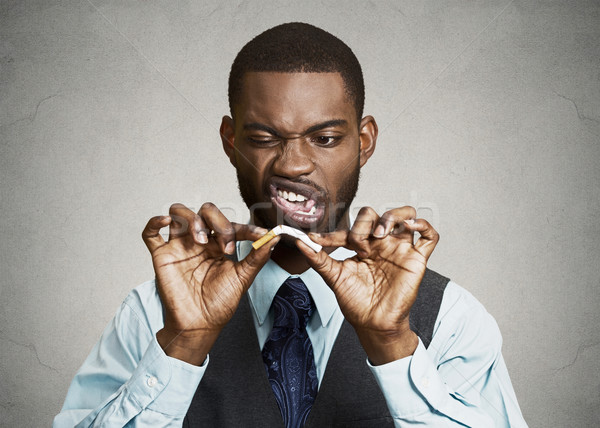 Sconvolto arrabbiato uomo d'affari sigaretta primo piano ritratto Foto d'archivio © ichiosea