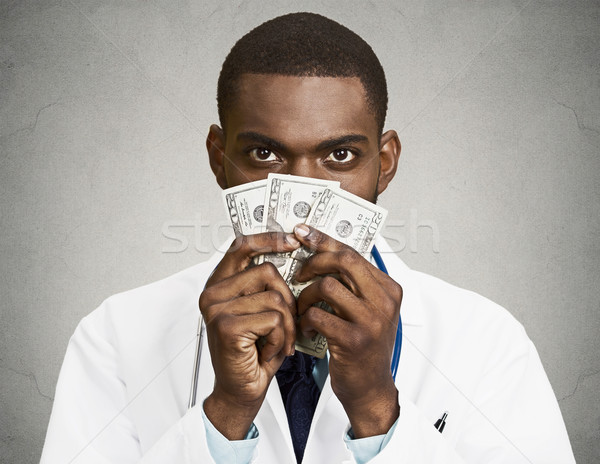 Greedy health care professional, doctor holding cash, money Stock photo © ichiosea