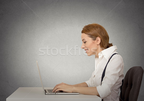 Stock photo: woman using her laptop computer