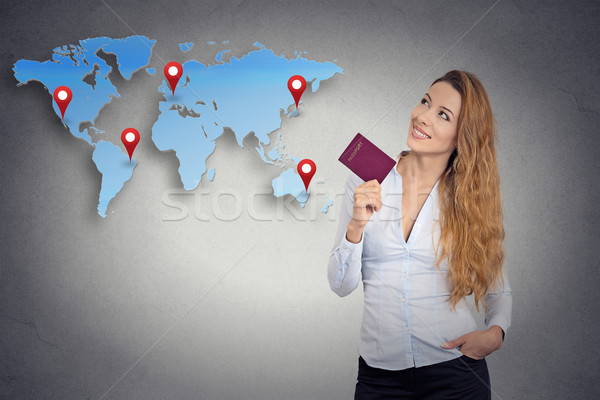 tourist young woman holding passport standing looking at world map  Stock photo © ichiosea